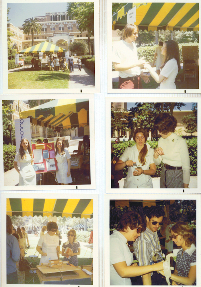 Students educate their fellow Trojans about occupational therapy, including a demonstration of potential uses for an adapted spoon, at the 1969 'OT Fair' in Alumni Park on the University Park Campus.