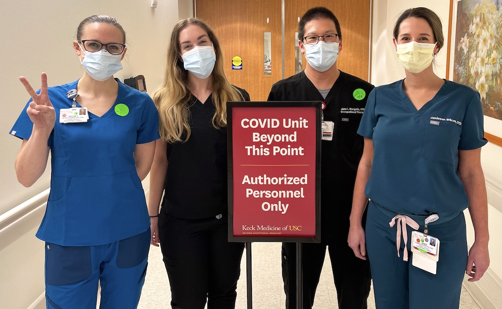 Group of clinicians by COVID sign