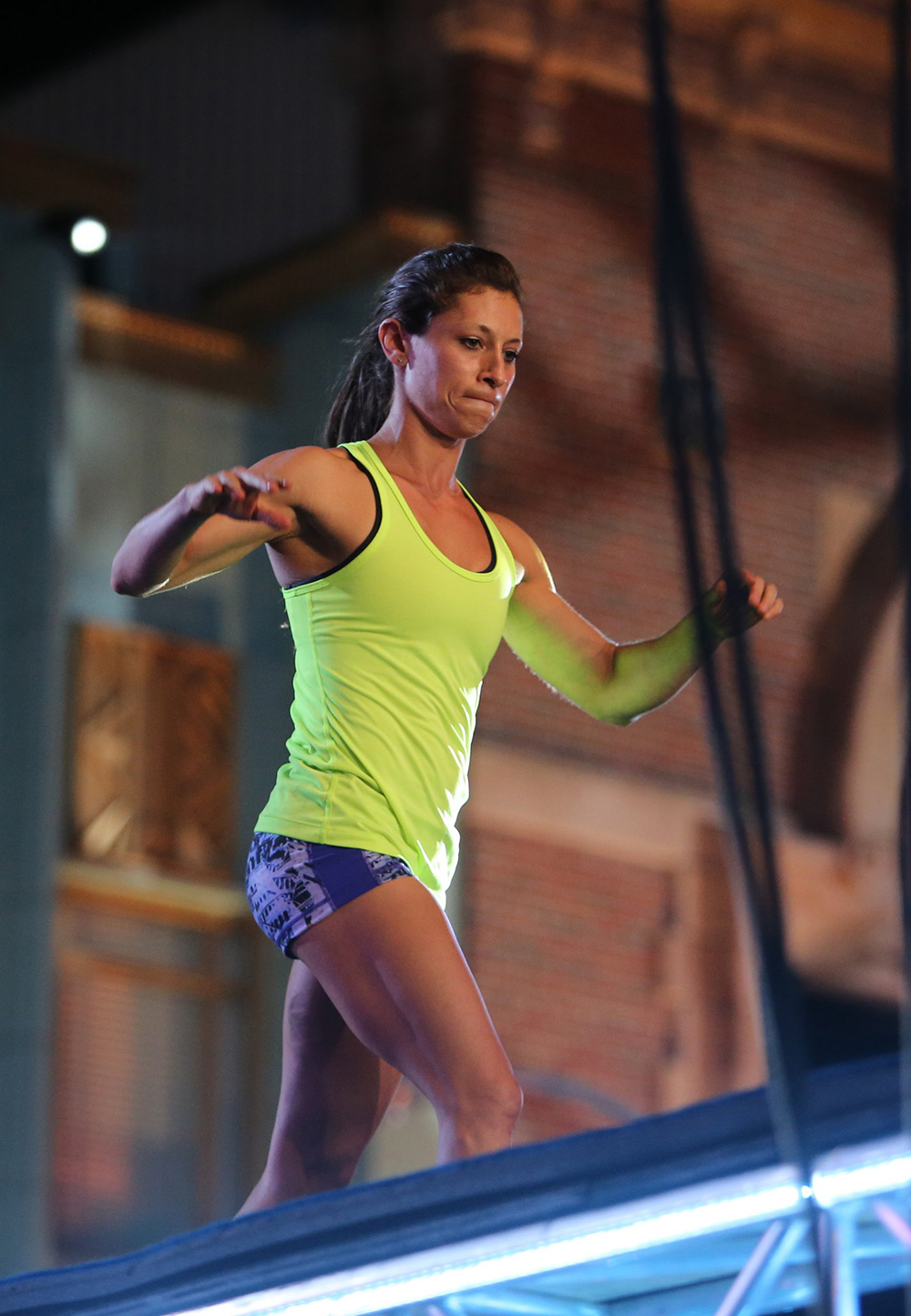 Karly Streisfeld MA '05 balances atop the American Ninja Warrior obstacle course