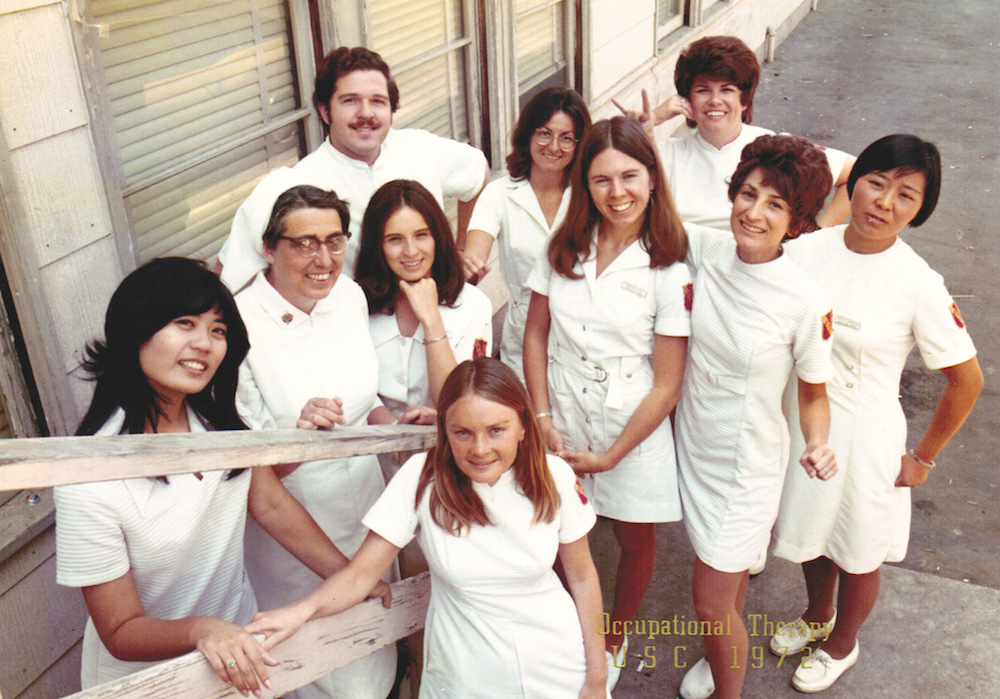 The 1972 class of Master of Arts students poses in white uniform with iconic USC shoulder patch. Photo courtesy of Kathy Hoffmann-Grotting