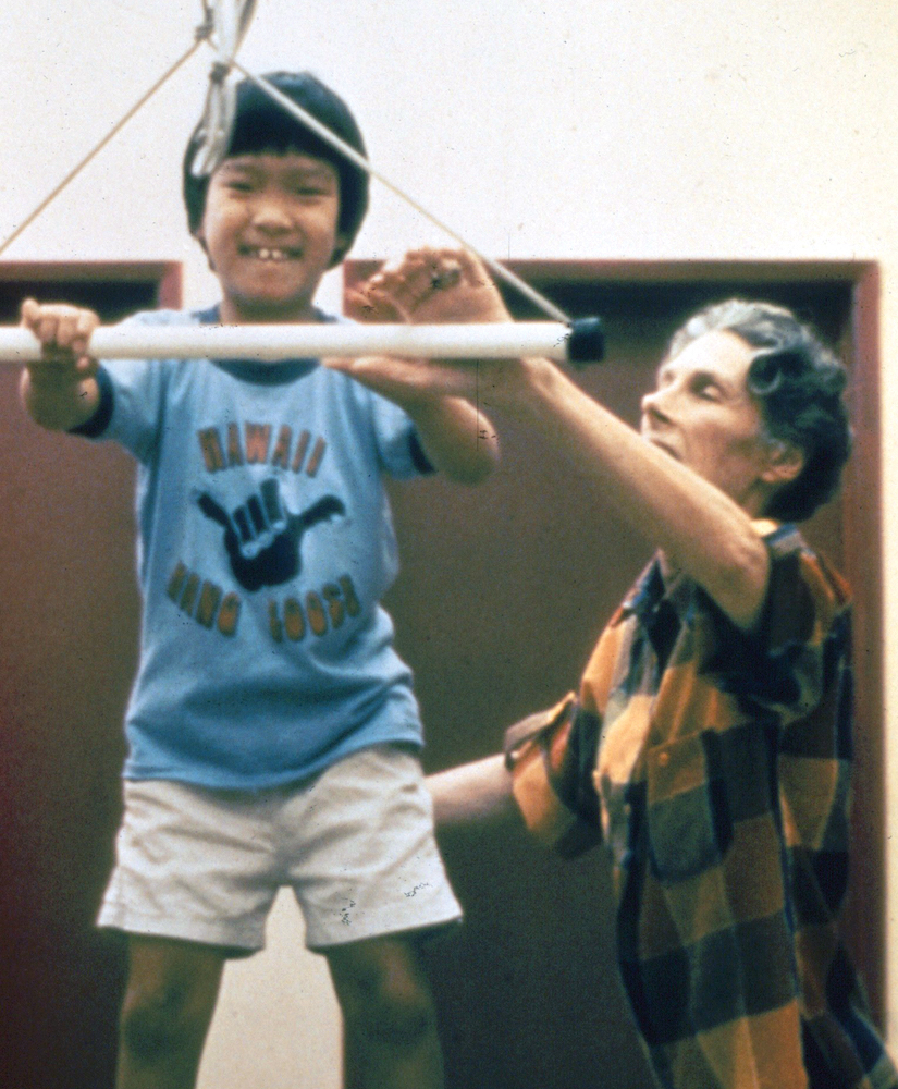 In this undated photograph, A. Jean Ayres, USC faculty member and pioneer of the sensory integration theory and intervention approach, positions an unidentified child before a trapeze swing at her Torrance clinic. Photo courtesy of Julie Bissell