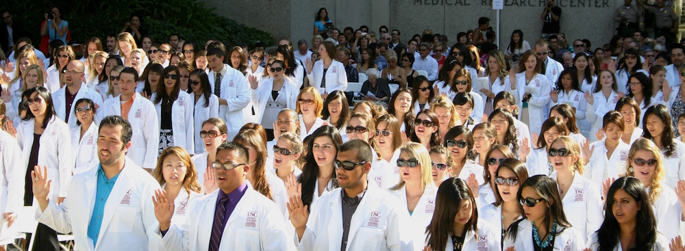 At the division's August 26th White Coat Ceremony, matriculating students stand and recite the 'Oath of an Occupational Therapist' in the Harry and Celesta Pappas Quad on the USC Health Sciences Campus. Photo by Kimberly Kelton/USC OSOT