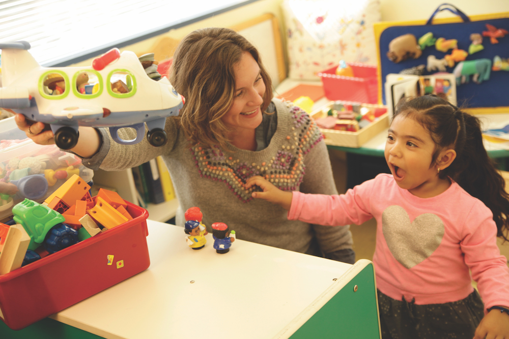 By using play to engage her pediatric patients, including 3-year-old Kelly Guerra (pictured here), who are diagnosed on the autism spectrum, Dr. Michelle Farmer works towards the goal of further developing their behavioral and fine motor skills | Photo by John Skalicky