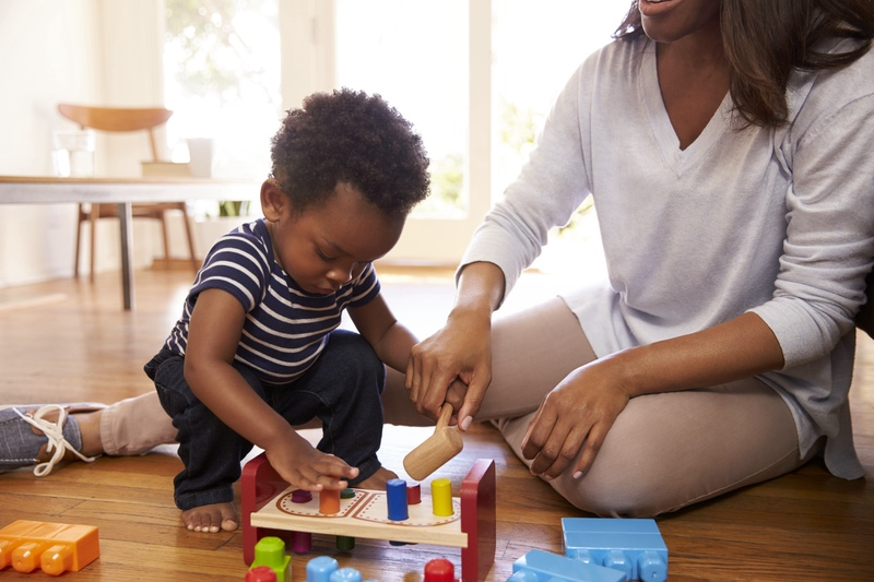 Child playing with blocks with mother