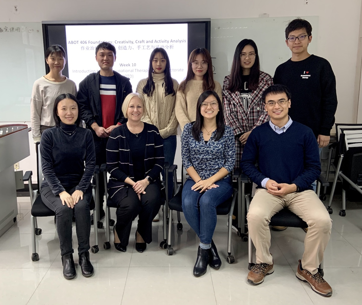 Dr. Julie McLaughlin Gray and Psalm Chang with PUHSC instructors Yijun (Jane) Liu and Dr. Liguo Qian and students