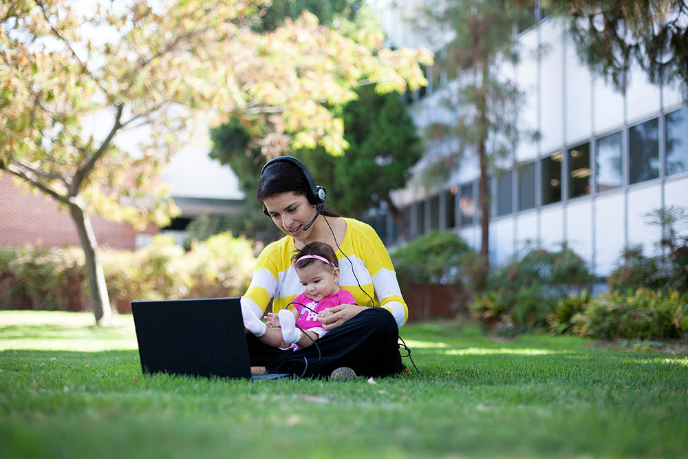 Current post-professional master's student Jennifer Bermudez tries out the online learning technology with daughter Mia. (Photo/Hong Le)