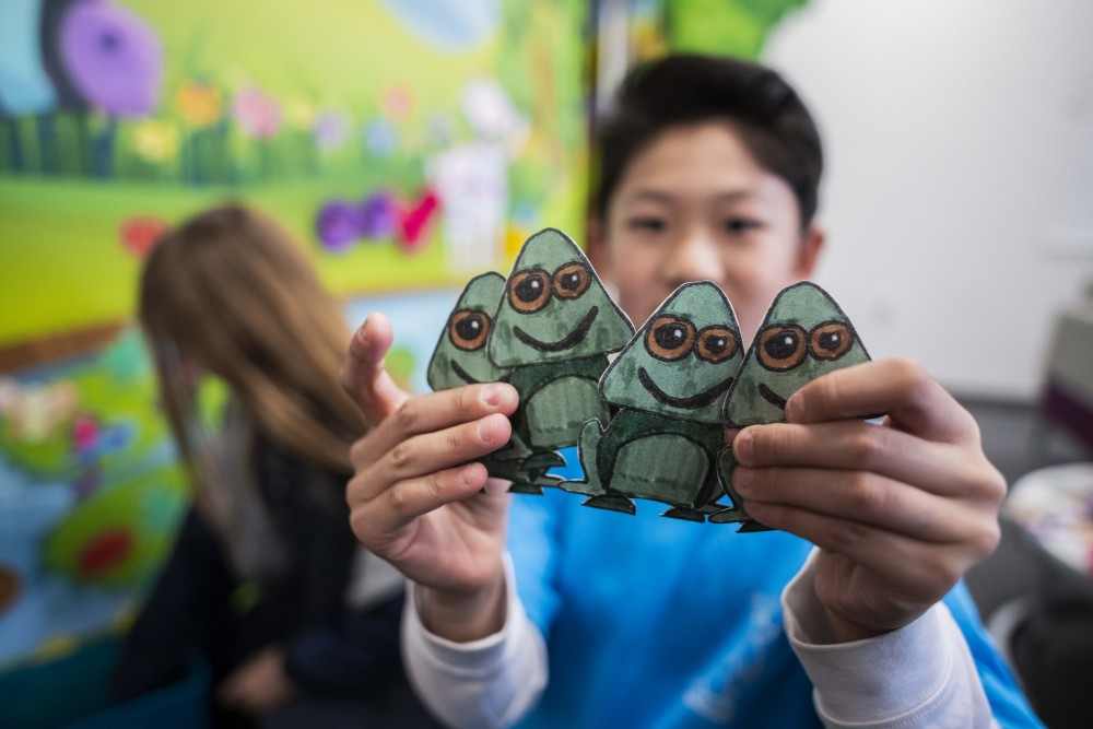 One student's hand-drawn frogs were made into magnetic objects that can be placed onto the interactive mural. (Photo by Hannah Benet)