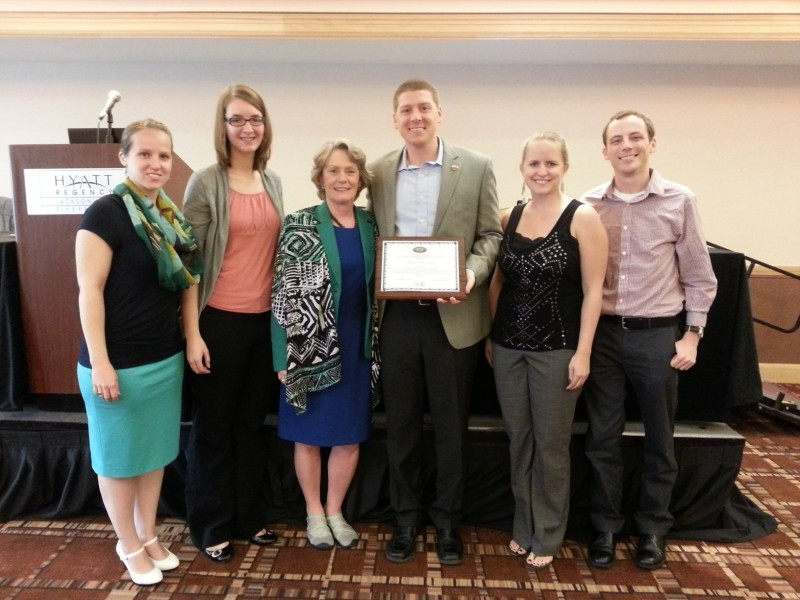 USC student Colin Lenington MA '14 (fourth from left), receives the 2013 PTE President's Award from (L-R) PTE Treasurer Rachel Proffitt, PTE President Kim Schoessow, AOTA President Ginny Stoffel, PTE Vice President Emily Kringle and PTE Secretary Elect Joseph Brey