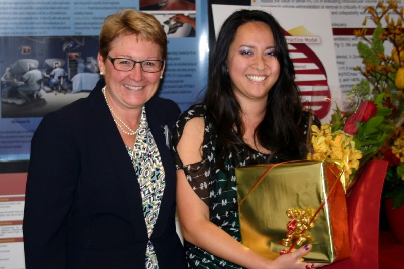 Phuong Nguyen, right, accepts the 2013 Care Partner of the Year award from Keck Hospital of USC Associate Administrator Theresa Murphy, left