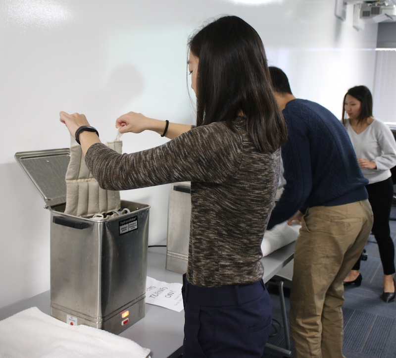 Master's student Kaley Kubokawa removes a hot pack from the hydrocollator