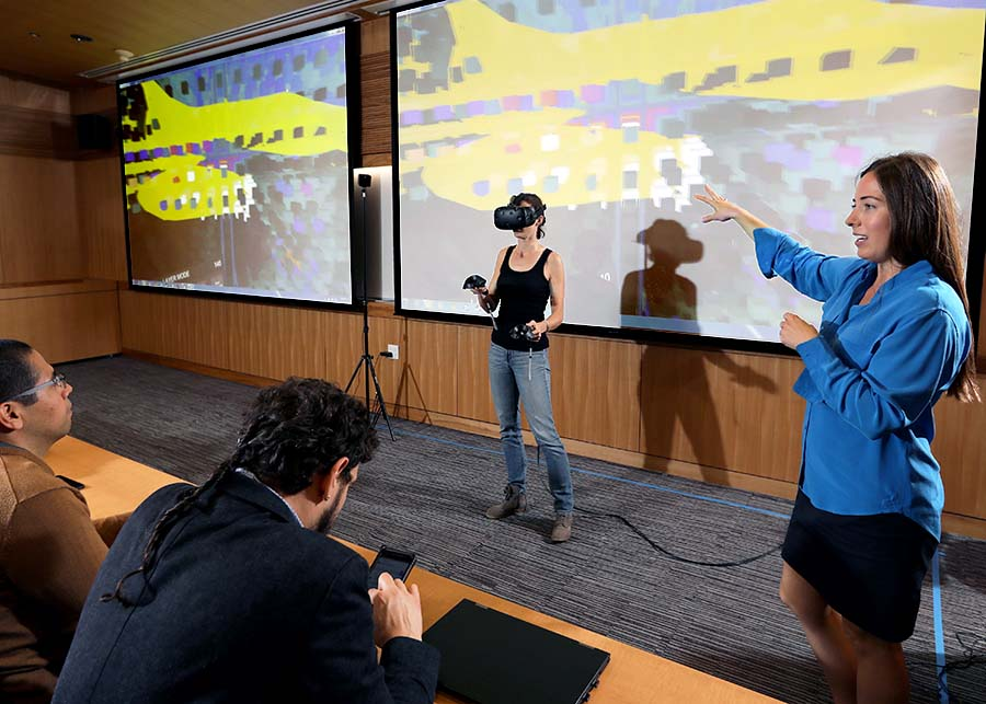 Dominique Duncan, assistant professor of neurology at the Keck School of Medicine of USC, explains a demonstration of her Virtual Brain Segmenter, a VR-based tool for correcting errors that are created during the MRI process. (Photo by Glenn Marzano)