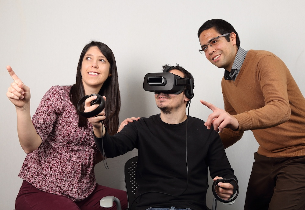 NPNL graduate students demonstrating arm-reaching rehabilitation games in virtual reality using the Oculus Rift