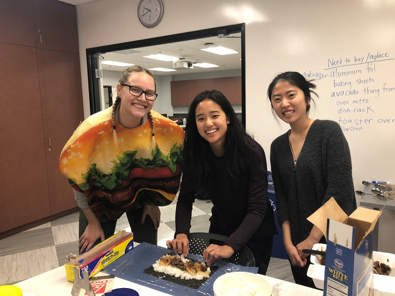 This image shows students making sushi in lab