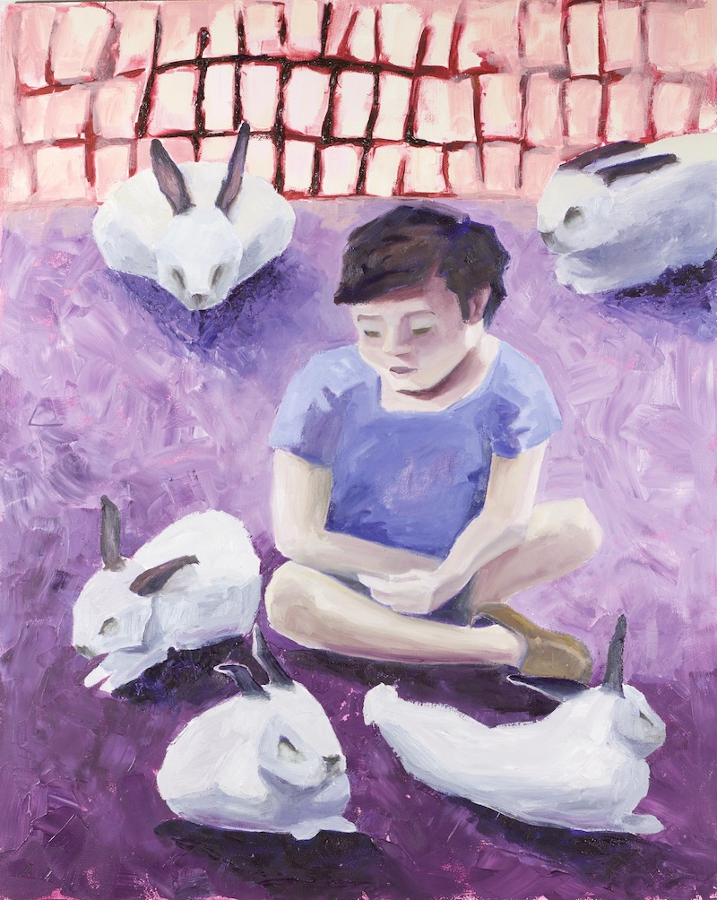 Child with rabbits