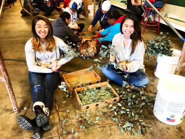 USC OT students, Alisa and Evelyn, helping decorate the float!