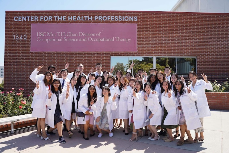 class on white coat ceremony in front of the CHP building