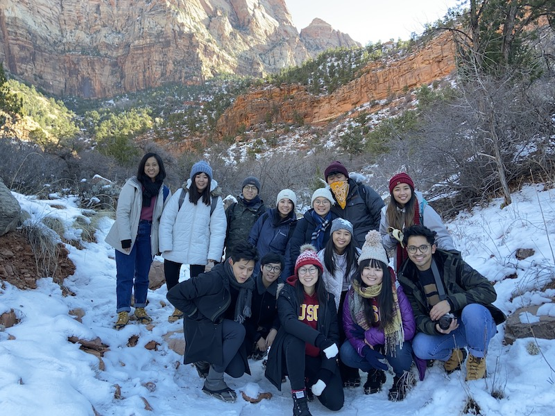 Another group photo with the mountain on the background but with more snow on the ground.