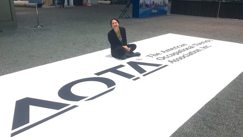 Rashelle with AOTA sign