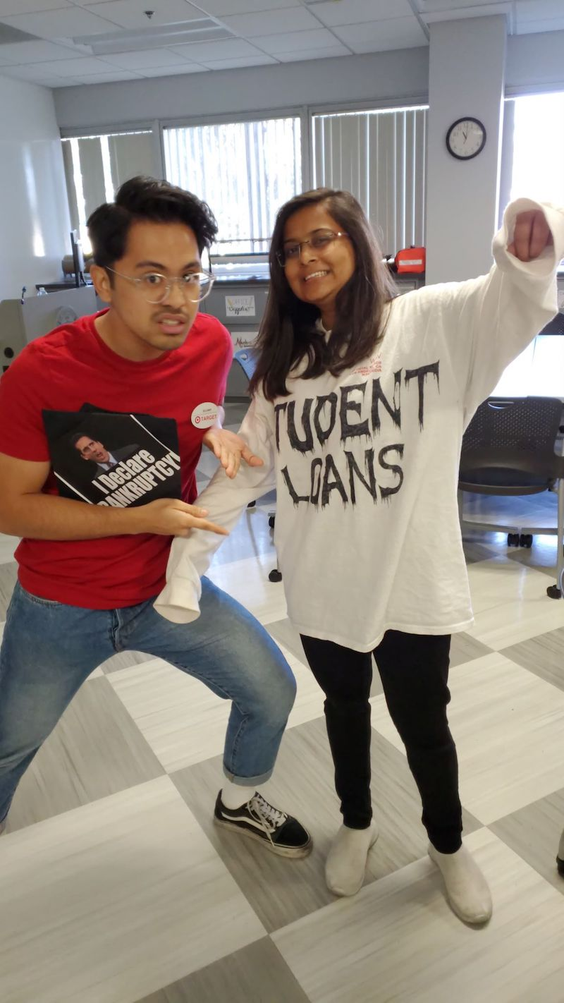 The man is dressed up as a target salesperson and the lady as student loans