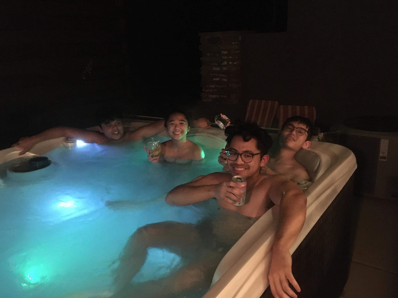Just a group photo of those who are enjoying the hot tub.