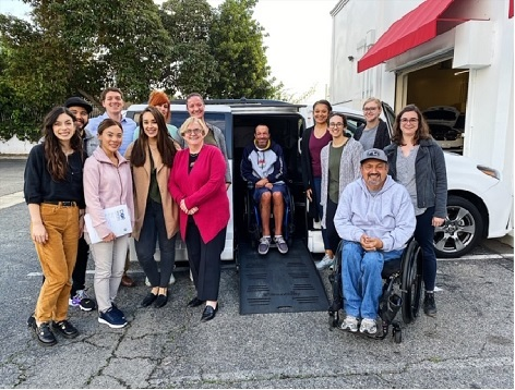 Pictured is the current Assistive Technology class with two clients from the visited site