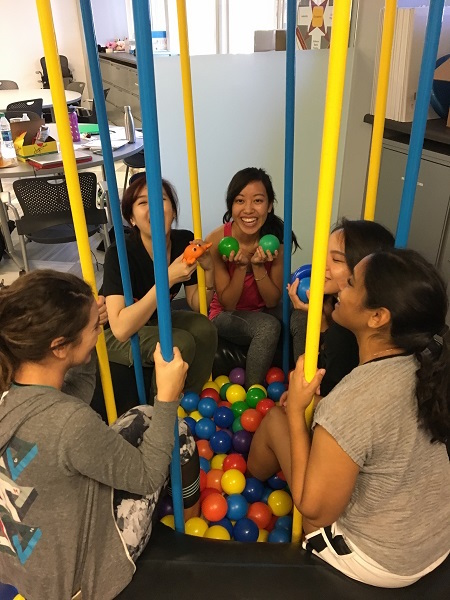 Photo of students playing in a ball pit