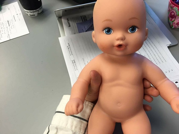 Photo of doll baby used to practice proper positioning in pediatrics lab