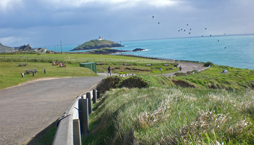 Coastal view of road, sea, and island in Ballycotton.