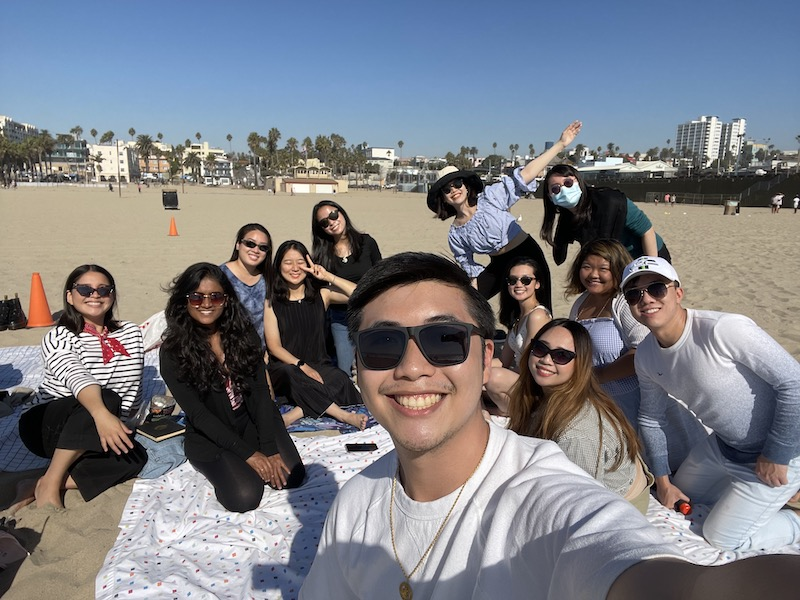 friends hanging out on beach
