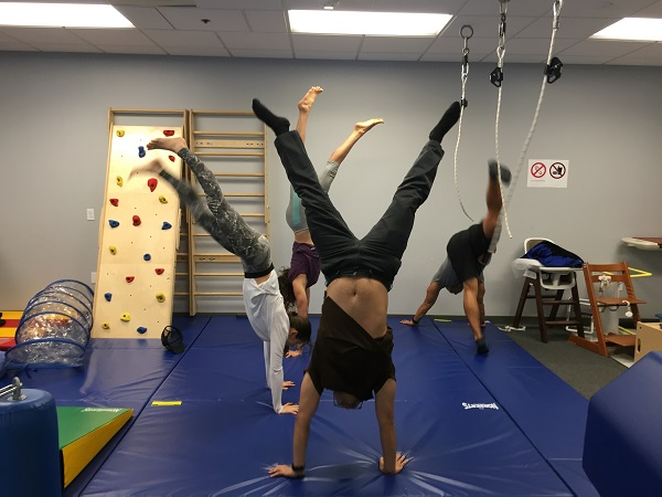 writer doing handstands in PEDS lab